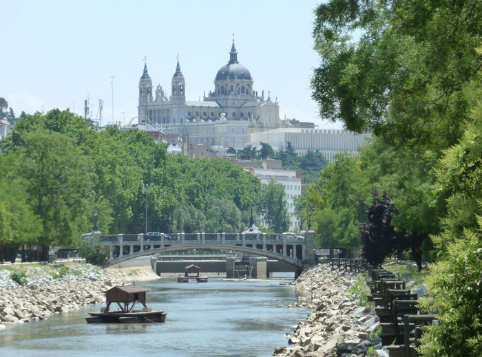 River Manzanares in Madrid (Spain). Centre: Queen Victoria Bridge. Background: Almudena Cathedral.