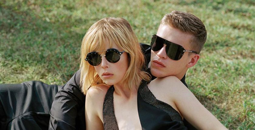 gafas de sol pareja vestidos de negro
